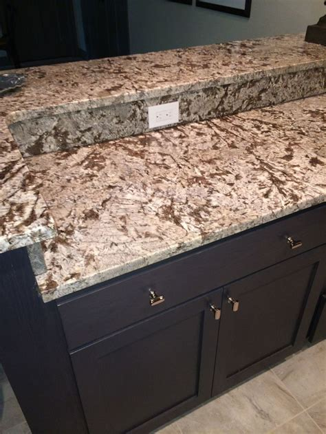 bianco antico polished granite island and raised bar with