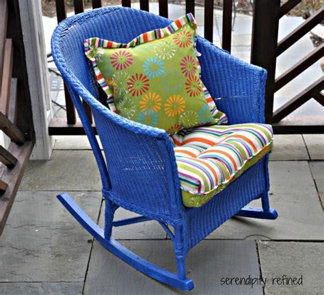 brightly painted wicker rocker w colorful throw pillows if you a goodwill or restore in