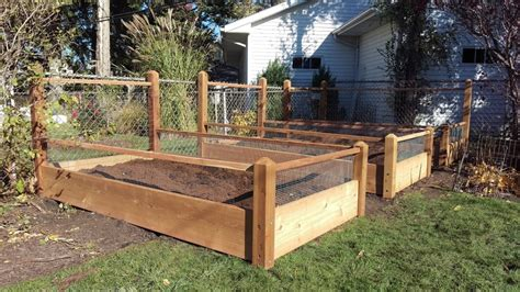 3 Raised Bed Gardens In A Corner 4 Foot Trellis And