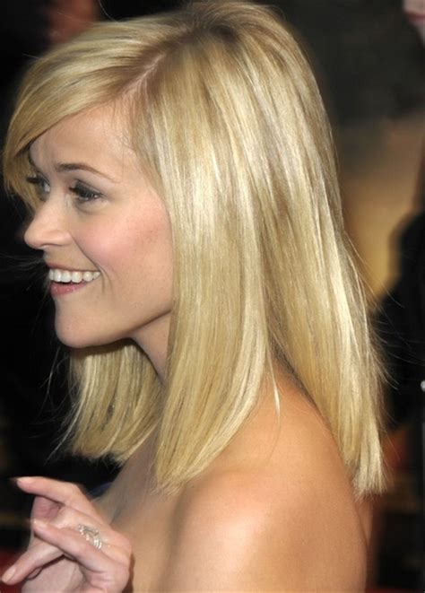 blunt end bob with subtle layers her medium length blonde hair was swept to the side with a