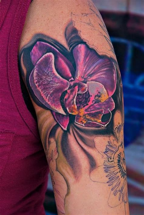 tattoo tropical flower cool bright violet tropical flower tattoo on upper arm