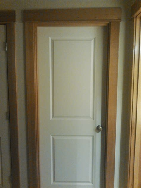 wood trim vs white trim stained wood trim and interior doors should i paint white