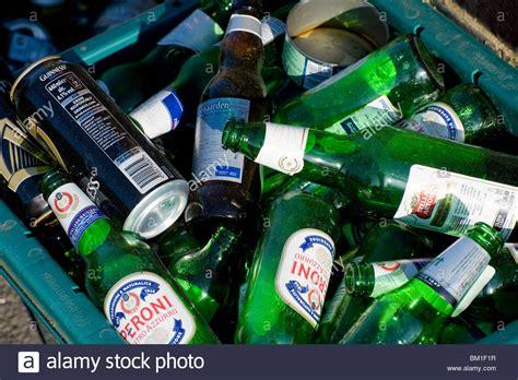 bin botol 8 in 1 glass bottles awaiting collection in a recycling bin