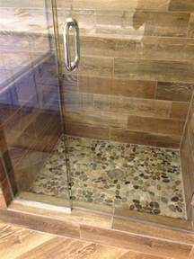 shower remodel look with mosaic flat rock pebbles