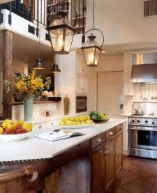 Traditional kitchen with lantern style lighting over kitchen island