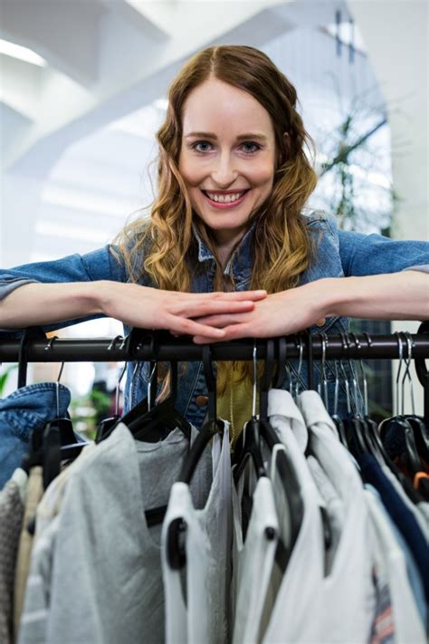 Womans Rack Leaning On A Clothes Rack Photo Free