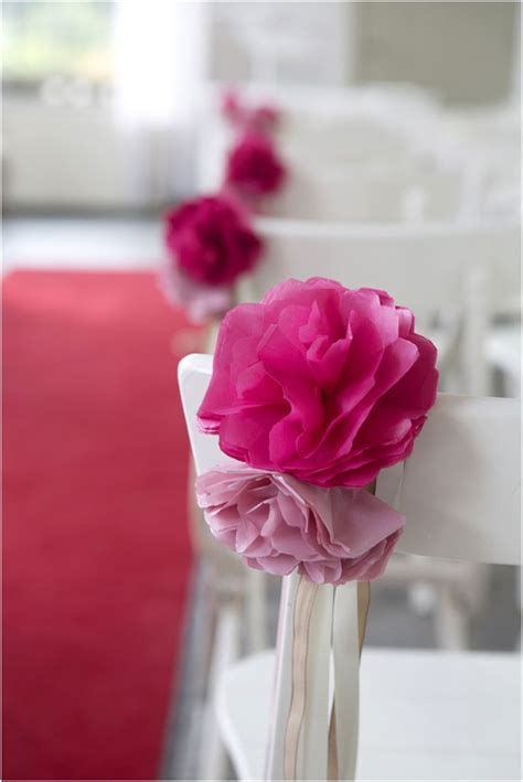 DIY paper flower chair decorations   pop of color down the