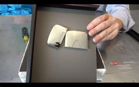 youtube gives new diamond play button to channels with 10 what s inside the youtube silver play button youtube