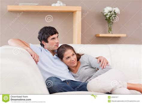 couples having on the couch couple being together on the couch royalty free stock