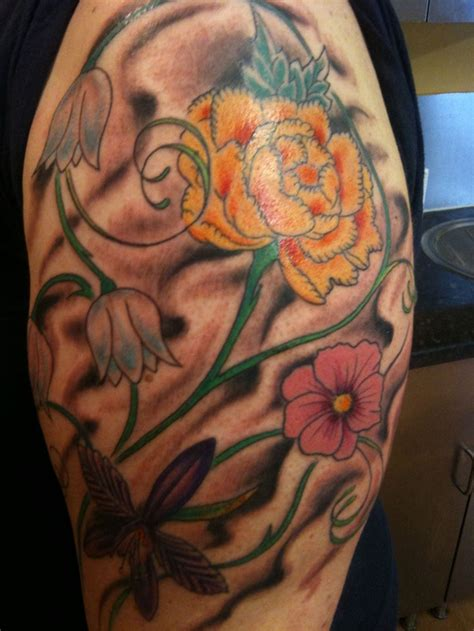 flower tattoo for arm colourful flower tattoo on upper arm