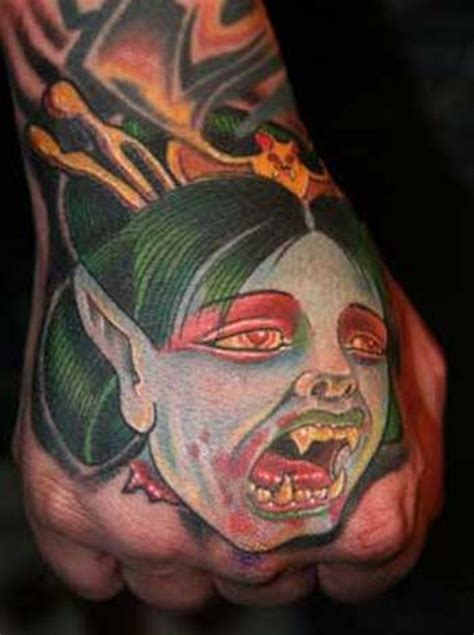 cartoon tattoo on hand cartoon like colored hand tattoo of vire woman face