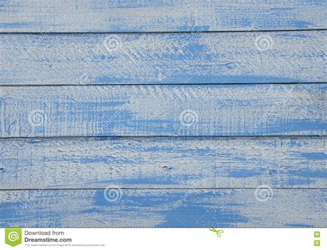 shabby chic blue and white wooden background with textured scratches and antique cracked paint