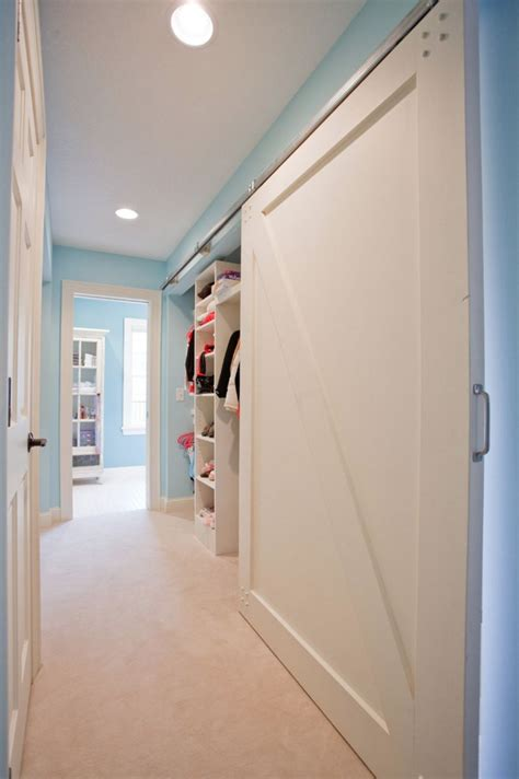 Closet Sliding Doors by Bringing Sliding Barn Doors Inside