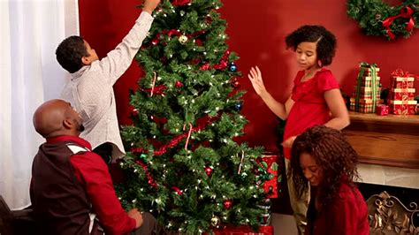 family christmas tree decoration family decorating tree together stock footage getty images