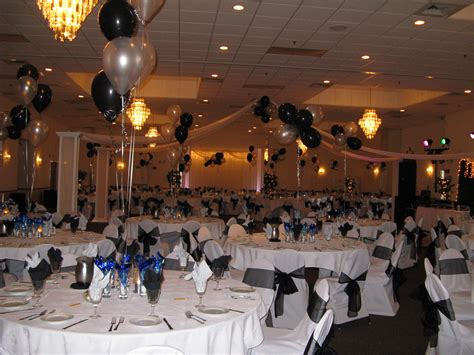 banquet party favors black and white balloons on the middle of table with utensils of fantastic banquet