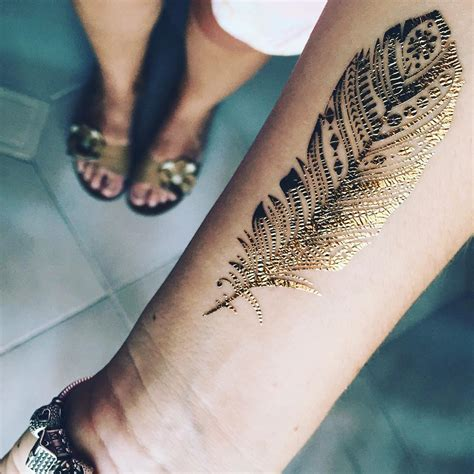 black and gold tattoo 50 gold designs and ideas for feel like a