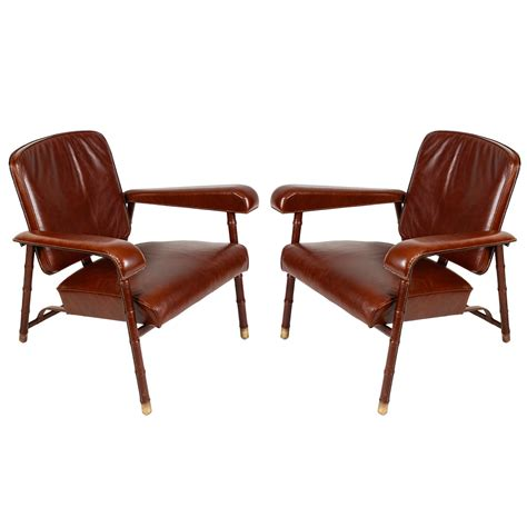 pair armchairs pair of armchairs by jacques adnet for sale at 1stdibs