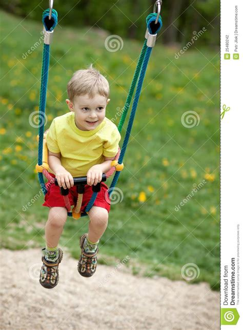 baby boy swing baby boy playing on swing stock photography image 25480242