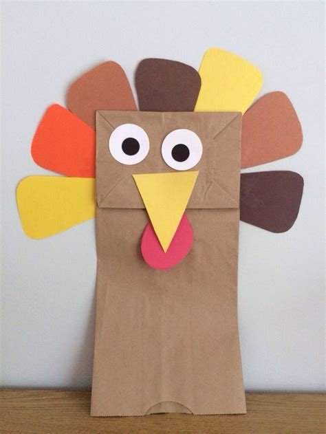 Thanksgiving Paper Bag Crafts - this paper bag turkey puppet is a simple thanksgiving