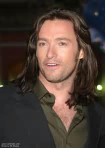 Hugh jackman sporting a long men s hairstyle