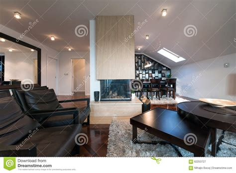 modern loft interior with fireplace in the middle of the