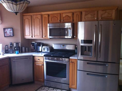 kitchen layout fridge next to cooker appliance update one year later and loving my maytag