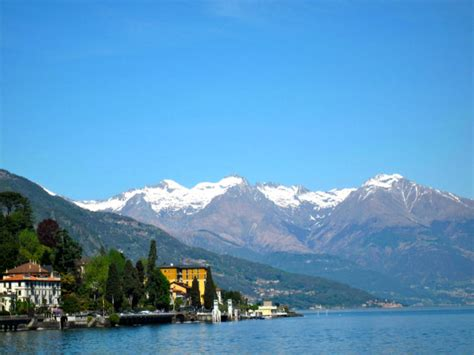 snow capped peaks towering  lake como  trusted