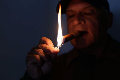 How To Light Cigar by Hat Tips 4 Steps To Properly Lighting A Cigar Vouchmag