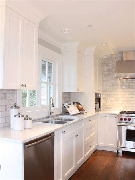 white kitchen cabinets grey tile back splash lots of