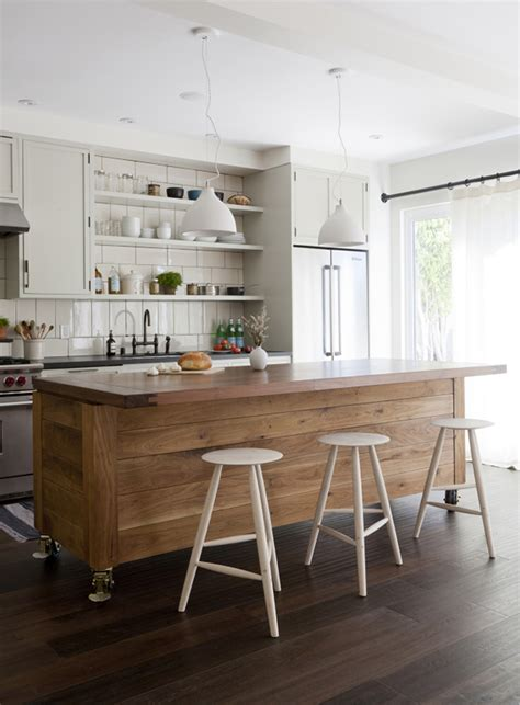 white kitchen island on wheels simo design puts large kitchen island on wheels