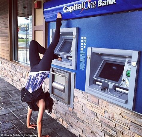 new year money atm hilaria baldwin retrieves from atm machine with