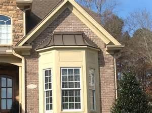 Metal roof over bay windows in raleigh