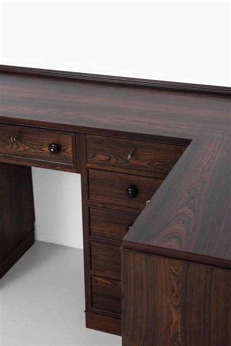 corner desk vanity storage unit in the manner of frode