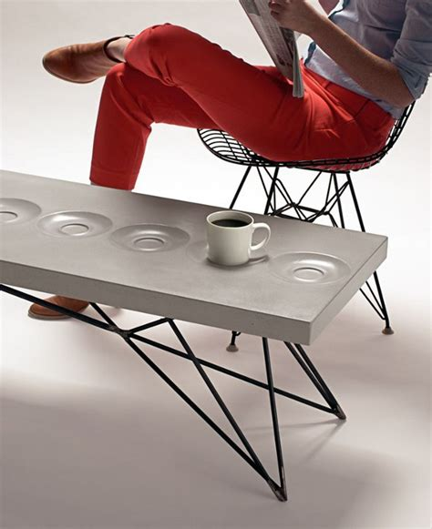 concrete coffee table with cast in saucers make
