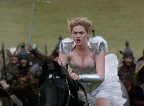 commercial girl riding horse kate upton flaunts cleavage in corset for game of war ad