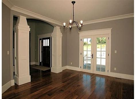 gray walls white trim the white trim gray walls and wood floors the door also for the front entrance