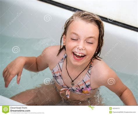 girl in bathroom naked little girl bathes in a bathroom stock photo image