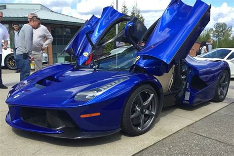 la blue blue laferrari shows up at high school car show