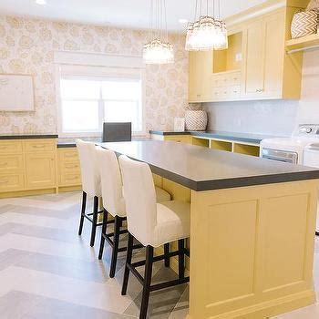 Yellow Laundry Room Cabinets With Gray Quartz Countertops Yellow Laundry