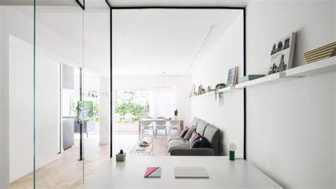 airy modern apartment in light shades digsdigs airy and light filled apartment with glass walls and brass