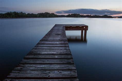 photo pier jetty lake calm water  image