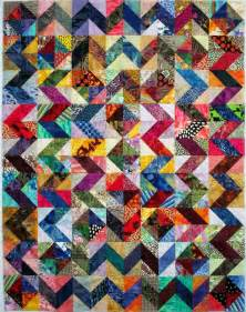 gorgeous scrappy half square triangles quilt top on the