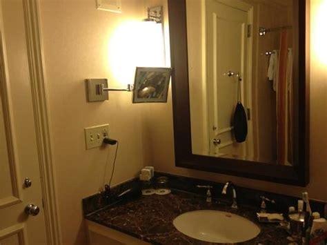 how to hang hair dryer in bathroom bathroom hair dryer in black bag hanging from hook on