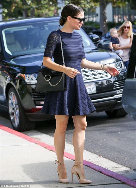 Get A Tone Green Dress Like Garners From Appearance On Letterman by Garner Parades Toned Legs In Fancy High Heels For