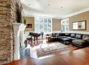 Casual living room doubling as family room with wood floor large