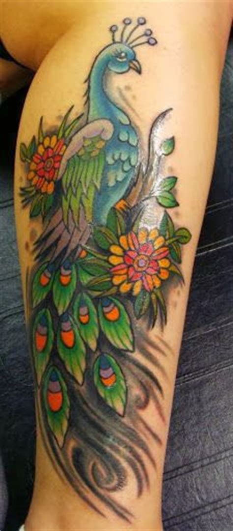 feather tattoo gun feminine pistol tattoo photos gun tattoo by rieter on
