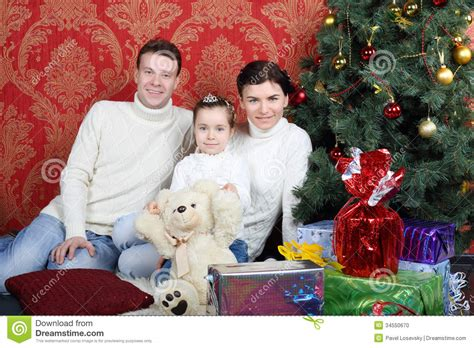 family christmas tree jarrettsville happy family sit on floor with gifts near tree stock photo image 34550670