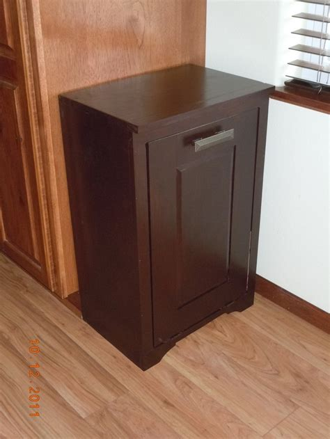 tilt out trash cabinet hide your trash bin by building a tilt out trash cabinet