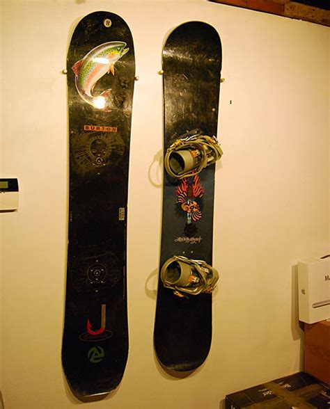 Snowboard Decor by Snowboard Storage Doubles As Decor