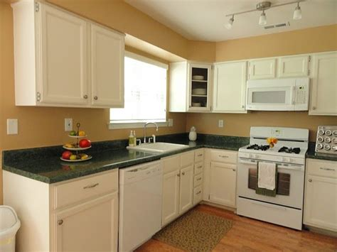 white kitchen cabinets with beige walls do not like the green countertops going for the look